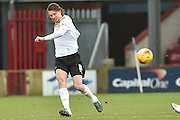 Alex Gilbey of colchester United kicks forward  during the Sky Bet League 1 match between Scunthorpe United and Colchester United at Glanford Park, Scunthorpe, England on 23 January 2016. Photo by Ian Lyall.