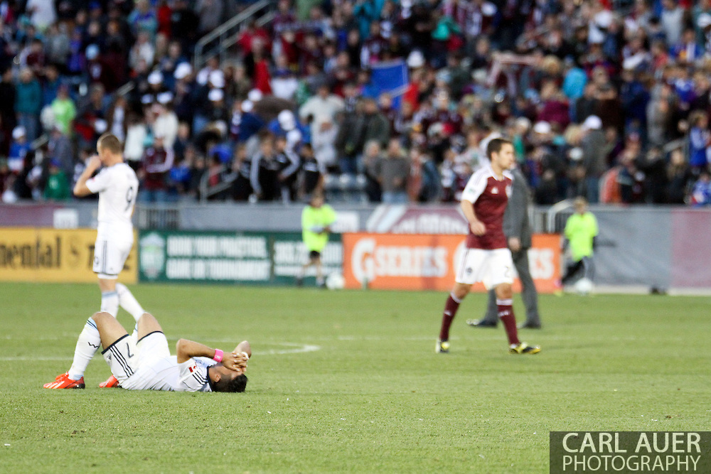 October 19th, 2013:  Vancouver Whitecaps FC forward Camilo Sanvezzo (7) lies on his back after the Whitecaps fell to the Colorado Rapids 3-2 in the MLS Soccer Match at Dick's Sporting Goods Park in Commerce City, Colorado