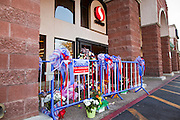 """15 JANUARY 2010 - TUCSON, AZ:  A memorial for Congresswoman GABRIELLE GIFFORDS and others shot Sat. Jan. 8 at the intersection of Ina and Oracle Roads in Tucson, AZ, Saturday, January 15. Six people were killed and 14 injured in the shooting spree at a """"Congress on Your Corner"""" event hosted by Arizona Congresswoman Gabrielle Giffords at a Safeway grocery store in north Tucson on January 8. Congresswoman Giffords, the intended target of the attack, was shot in the head and seriously injured in the attack but is recovering. Doctors announced that they removed her breathing tube Saturday, one week after the attack. The alleged gunman, Jared Lee Loughner, was wrestled to the ground by bystanders when he stopped shooting to reload the Glock 19 semi-automatic pistol. Loughner is currently in federal custody at a medium security prison near Phoenix.    PHOTO BY JACK KURTZ"""