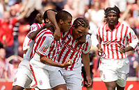 Photo. Glyn Thomas.Digitalsport<br /> Stoke City v Wolverhampton Wanderers. <br /> Coca Cola Championship. 08/08/2004.<br /> Stoke's Darel Russell (second from R) is mobbed by teammates after scoring his side's first goal.