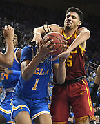 Feb 28, 2019; Los Angeles, CA, USA; UCLA Bruins center Moses Brown (1) is defended by Southern California Trojans forward Bennie Boatwright (25)  in the second half at Pauley Pavilion. UCLA defeated USC 93-88 in overtime.