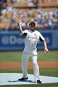 LOS ANGELES, CA - JULY 28:  Charm Lee, the head of the Korea Tourism Organization, throws out a celebratory first pitch before the Los Angeles Dodgers game against the Cincinnati Reds on Sunday, July 28, 2013 at Dodger Stadium in Los Angeles, California. The Dodgers won the game in a 1-0 shutout. (Photo by Paul Spinelli/MLB Photos via Getty Images) *** Local Caption *** Charm Lee