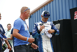 August 10, 2018 - Brooklyn, Michigan, United States of America - Kyle Larson (42) hangs out in the garage during practice for the Consumers Energy 400 at Michigan International Speedway in Brooklyn, Michigan. (Credit Image: © Justin R. Noe Asp Inc/ASP via ZUMA Wire)