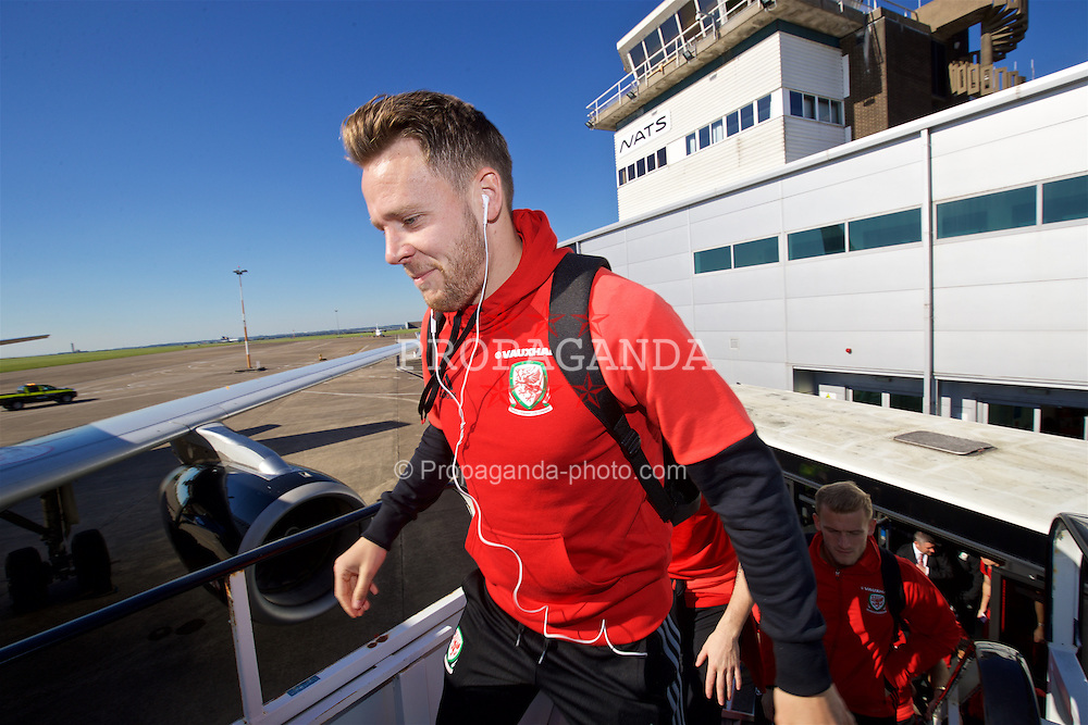 CARDIFF, WALES - Wednesday, October 5, 2016: Wales' Chris Gunter boards the team plane at Cardiff Airport as the team travel to Vienna ahead of the 2018 FIFA World Cup Qualifying Group D match against Austria. (Pic by David Rawcliffe/Propaganda)