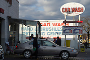 Workers wash and shine cars at Queensboro Car Wash, located in Long Island City along 21st Street. The street is peppered with car washes as it approaches the Queensboro Bridge.