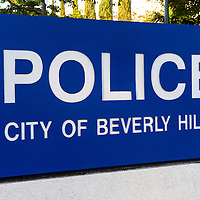 Picture of the City of Beverly Hills Police sign in Beverly Hills California. Beverly Hills is a wealthy town in Los Angeles County in Southern California. Photo was taken in 2012 and is high resolution.