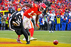 Jan 19, 2020; Kansas City, Missouri, USA; Kansas City Chiefs wide receiver Byron Pringle (13) runs into back judge Perry Paganelli (46) during the second half in the AFC Championship Game against the Tennessee Titans at Arrowhead Stadium. Mandatory Credit: Denny Medley-USA TODAY Sports