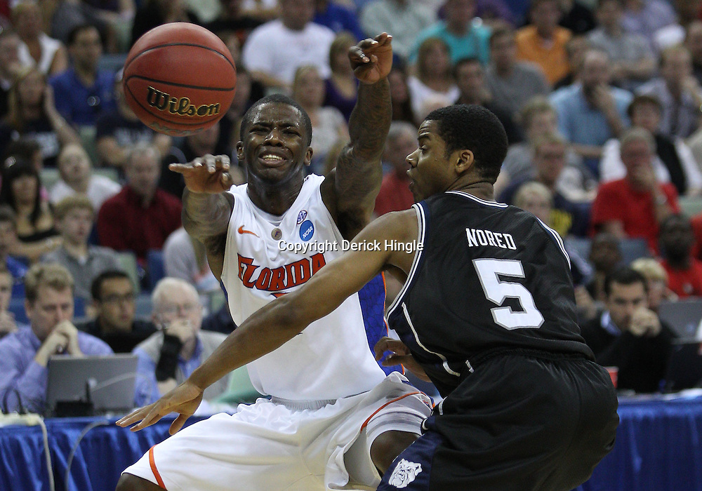 Mar 26, 2011; New Orleans, LA; Florida Gators guard Kenny Boynton (1) is defended by Butler Bulldogs guard Ronald Nored (5) during the second half of the semifinals of the southeast regional of the 2011 NCAA men's basketball tournament at New Orleans Arena.   Mandatory Credit: Derick E. Hingle
