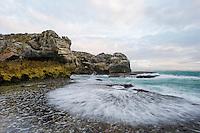 Wave break along the rugged sandstone rock platforms and coastline, Arniston, Western Cape, South Africa
