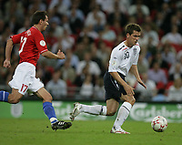 Photo: Rich Eaton.<br /> <br /> England v Russia. UEFA European Championships Qualifying. 12/09/2007. England's Michael Owen (R) attacks