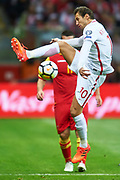 Warsaw, Poland - 2017 October 08: Grzegorz Krychowiak of Poland fights for the ball during soccer match Poland v Montenegro - FIFA 2018 World Cup Qualifier at PGE National Stadium on October 08, 2017 in Warsaw, Poland.<br /> <br /> Mandatory credit:<br /> Photo by &copy; Adam Nurkiewicz / Mediasport<br /> <br /> Adam Nurkiewicz declares that he has no rights to the image of people at the photographs of his authorship.<br /> <br /> Picture also available in RAW (NEF) or TIFF format on special request.<br /> <br /> Any editorial, commercial or promotional use requires written permission from the author of image.