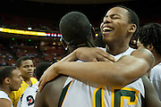 Robert Pearson (1) of Dallas Madison hugs teammate JD Wallace after defeating Houston Yates during the UIL 3A state championship game at the Frank Erwin Center in Austin on Saturday, March 9, 2013. (Cooper Neill/The Dallas Morning News)