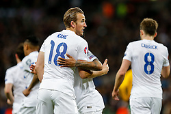 Harry Kane of England (Tottenham Hotspur) celebrates with Raheem Sterling (Liverpool) after scoring a goal with a header to make it 4-0 - Photo mandatory by-line: Rogan Thomson/JMP - 07966 386802 - 27/03/2015 - SPORT - FOOTBALL - London, England - Wembley Stadium - England v Lithuania UEFA Euro 2016 Qualifier.