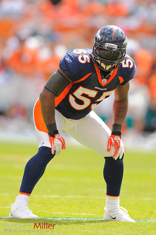 Denver Broncos outside linebacker D.J. Williams (55) during the Broncos 18-15 overtime win against the Miami Dolphins at Sun Life Stadium on Oct. 22, 2011 in Miami Gardens, Fla.  ...©2011 Scott A. Miller