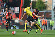 AFC Bournemouth's striker Glenn Murray battles with Watford FC captain, striker Troy Deener during the Barclays Premier League match between Bournemouth and Watford at the Goldsands Stadium, Bournemouth, England on 3 October 2015. Photo by Mark Davies.