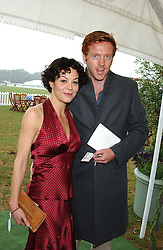 DAMIAN LEWIS and HELEN McCRORY at the 2005 Cartier International Polo between England & Australia held at Guards Polo Club, Smith's Lawn, Windsor Great Park, Berkshire on 24th July 2005.<br /><br />NON EXCLUSIVE - WORLD RIGHTS