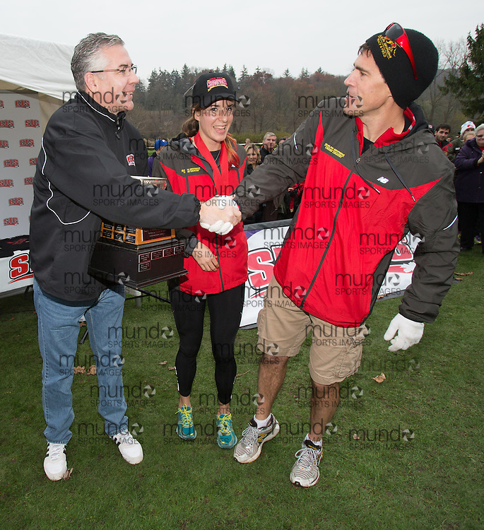 London, Ontario ---2012-11-10---  Guelph Gryphons women's coach Dave Scott Thomas receives the championship trophy following their victory at the 2012 CIS Cross Country Championships at Thames Valley Golf Course in London, Ontario, November 10, 2012. .GEOFF ROBINS Mundo Sport Images