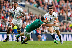 England replacement Owen Farrell is tackled by Ireland Lock Devin Toner - Mandatory byline: Rogan Thomson/JMP - 07966 386802 - 05/09/2015 - RUGBY UNION - Twickenham Stadium - London, England - England v Ireland - QBE Internationals 2015.