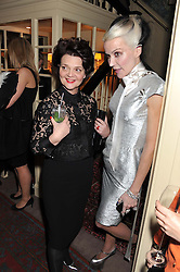 Left to right, DAPHNE GUINNESS and LULU GUINNESS at a party hosted by Justine Picardie, Editor-in-Chief of Harper's Bazaar UK and Glenda Bailey, Editor-in-Chief of Harper's Bazaar US to celebrate the end of London Fashion Week and the biggest-ever March issues of Harper's Bazaar, held at Mark's Club, Charles Street, London on 19th February 2013.