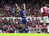 Foto: Peter Spurrier, Digitalsport<br /> NORWAY ONLY<br /> <br /> 15/05/2004  - 2003/04 Premiership Football - Arsenal v Leicester City<br /> <br /> Paul Dickov raises his arms to the crowd after scoring his goal.