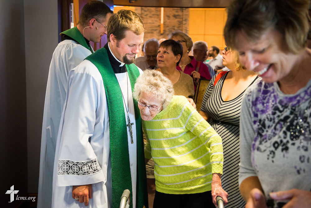 The Rev. Christopher Hull, senior pastor, hugs Alfreda Laesch after worship Sunday, July 27, 2014, at Christ Lutheran Church in Normal, Ill. LCMS Communications/Erik M. Lunsford