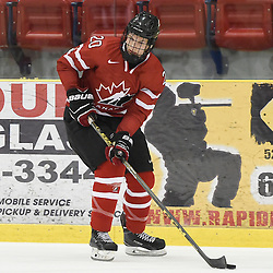 WELLINGTON, - Dec 11, 2015 -  Exhibition Game 2- Team USA vs Team Canada East at the 2015 World Junior A Challenge at the Wellington District Community Centre, ON. Matt Cairns #20 of Team Canada East skates with the puck during the third period.<br /> (Photo: Andy Corneau / OJHL Images)