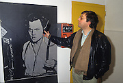 Massimo Cirri, author and presenter of Radio Popolare (Popular Radio) hold the phone to Orson Welles at the microphones of CBS, Milan, 1992. Radio Popolare is an Italian free and indipendent radio station; its programs are broadcasted on FM and streaming and by satellite. &copy; Carlo Cerchioli<br /> <br /> Massimo Cirri, autore e conduttore di Radio Popolare, r Milano, 1992. Radio Popolare, &egrave; una radio di informazione libera e indipendente; i suoi programmi sono trasmessi in FM e streaming e via satellite.