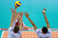 (L) Jakub Jarosz from Poland attacks against Julien Lyneel and Gerald Hardy Dessources both from France during the 2013 CEV VELUX Volleyball European Championship match between Poland and France at Ergo Arena in Gdansk on September 21, 2013.<br /> <br /> Poland, Gdansk, September 21, 2013<br /> <br /> Picture also available in RAW (NEF) or TIFF format on special request.<br /> <br /> For editorial use only. Any commercial or promotional use requires permission.<br /> <br /> Mandatory credit:<br /> Photo by © Adam Nurkiewicz / Mediasport