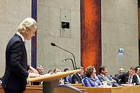 Nederland. Den Haag, 26 oktober 2010.<br /> De Tweede Kamer debatteert over de regeringsverklaring van het kabinet Rutte.<br /> Hilariteit in vak K als PVV leider Geert Wilders Alexander Pechtold herinnert aan diens uitspraak te gaan emigreren als Wilders minister-president zou worden. Pechtold noemt Wilders de zonnekoning...<br /> Kabinet Rutte, regeringsverklaring, tweede kamer, politiek, democratie. regeerakkoord, gedoogsteun, minderheidskabinet, eerste kabinet Rutte, Rutte1, Rutte I, debat, parlement<br /> Foto Martijn Beekman