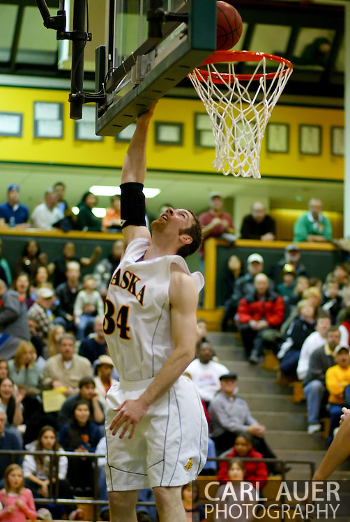 1/13/2006: Junior forward Carl Arts (34) of the UAA Seawolves goes in for two of his career high 27 to lead Alaska Anchorage to a comeback victory over Northwest Nazarene, 60-57, in men?s basketball action at the Wells Fargo Sports Complex on Saturday.