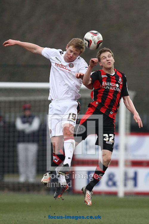 Picture by Daniel Chesterton/Focus Images Ltd +44 7966 018899.23/02/2013.Barry Robson of Sheffield Utd and Eunan O'Kane of Bournemouth compete for a header during the npower League 1 match at the Seward Stadium, Bournemouth.