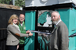 Scottish Green party candidates for the Lothians Alison Johnstone (left) and Andy Wightman (centre) officially unveil the latest piece of art by Leith-based artist Stewart Bremner (right), a specially-designed and painted decommissioned police box on Leith Walk, Edinburgh.<br /> <br /> <br /> &copy; Dave Johnston/ EEm