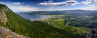 North Cowichan Valley, Genoa Bay, panoramic aerial nature scenery with mountains in the background from a Mount Tzouhalem mountain top lookout. North Cowichan, Vancouver Island, British Columbia, Canada
