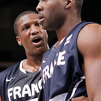 15 July 2012: Yakhouba Diawara of Team France calms down Florent Pietrus during a pre-Olympic exhibition game won 75-70 by Spain over France, at the Palais Omnisports de Paris Bercy, in Paris, France.