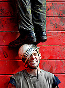 First year Brian Norwick bites his teeth together as another member of his flight stands on his head in an attempt to climb over a wall during the annual Obstacle Course challenge at the Royal Military College of Canada in Kingston, Ontario, on September 29.