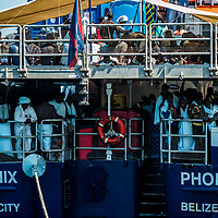 Port of Reggio Calabria 12-06-2017 Landing operations of the NGO Moas Phoenix Ship of over three hundred men, women, children and a corpse on the dock of Reggio Calabria harbor