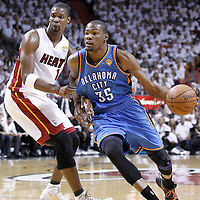 19 June 2012: Oklahoma City Thunder small forward Kevin Durant (35) drives past Miami Heat power forward Chris Bosh (1) during the first quarter of Game 4 of the 2012 NBA Finals, Thunder at Heat, at the AmericanAirlinesArena, Miami, Florida, USA.