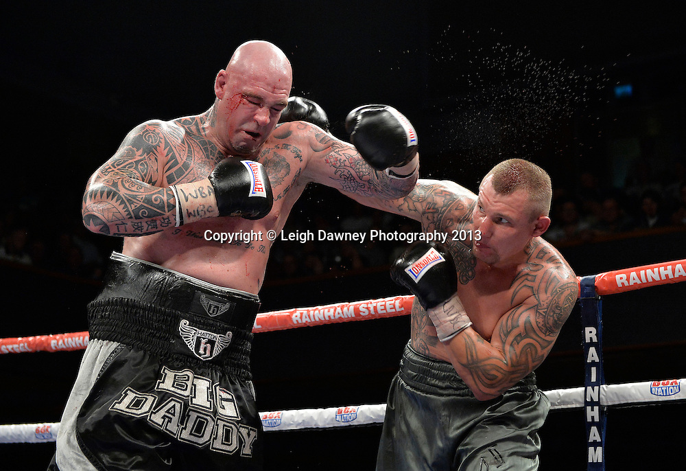 Lucas Browne (black/grey shorts) fights Andriy Rudenko for the WBA Intercontinental & WBC EUR-ASIA- Pacific Heavyweight Championship at Wolverhampton Civic Hall, Wolverhampton, 1st August 2014. Promoted by Ricky Hatton on the Frank Warren in association with PJ Promotions bill. © Credit: Leigh Dawney Photography.