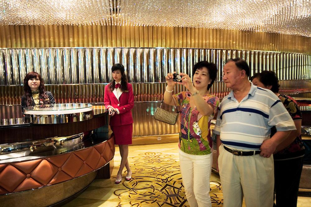 Guests and staff at the Lisboa. Macau, China. 2008