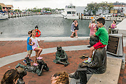 "Annapolis, Maryland - June 05, 2016: People congregate at the Kunta Kinte-Alex Haley Memorial park in historic Annapolis Sunday June 5th, 2016. Earlier that day a perigean spring tide brought some of the highest water levels of the year to the coastal town and partially flooded the park. <br /> <br /> A perigean spring tide brings nuisance flooding to Annapolis, Md. These phenomena -- colloquially know as a ""King Tides"" -- happen three to four times a year and create the highest tides for coastal areas, except when storms aren't a factor. Annapolis is extremely susceptible to nuisance flooding anyway, but the amount of nuisance flooding has skyrocketed in the last ten years. Scientists point to climate change for this uptick. <br /> <br /> <br /> CREDIT: Matt Roth for The New York Times<br /> Assignment ID: 30191272A"