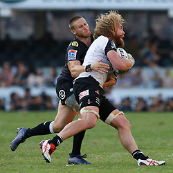 DURBAN, SOUTH AFRICA - MARCH 10: Cameron Wright of the Cell C Sharks tackling Willem Britz (captain) of the HITO-Communications Sunwolves during the Super Rugby match between Cell C Sharks and Sunwolves at Jonsson Kings Park Stadium on March 10, 2018 in Durban, South Africa. (Photo by Steve Haag/Gallo Images)