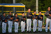 Players from the Beijing-based Powerbaseball Angels Little League team line up for the national anthem during a game against the Acton-Boxborough Youth Baseball (ABYB) Bay State A Little League team at Veterans Field in Acton, Aug. 6, 2018. Acton won the game.   [Wicked Local Photo/James Jesson]