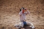 24 FEBRUARY 2002, TUCSON, ARIZONA, USA: A cowboy sits in the dirt after being bucked off a saddle bronc at the Fiesta de los Vaqueros Rodeo in Tucson, Az, Sunday, Feb. 24, 2002. The Fiesta de los Vaqueros Rodeo has been held for 77 years and is one of the largest professional rodeos in the US..PHOTO BY JACK KURTZ