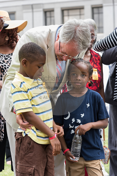 Charleston Mayor John Tecklenburg, comforts family members of victims of the Mother Emanuel African Methodist Episcopal Church massacre on the 2nd anniversary of the mass shooting June 17, 2017 in Charleston, South Carolina. Nine members of the historic African-American church were gunned down by a white supremacist during bible study on June 17, 2015.