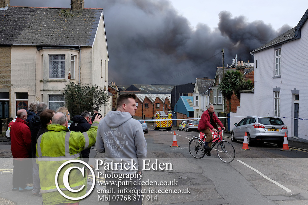 25 January 2016, News, Cowes, Isle of Wight, England, Large fire in former J Samuel White ship yard. Fire started in a garage unit, and rapidley spread to boat building and fabrication units. A fire has broken out at a workshop on an industrial estate on the Isle of Wight.<br /><br />Isle of Wight Fire and Rescue said more than 30 firefighters were tackling the blaze at Medina Village on Bridge Road in Cowes.<br /><br />Fifty fibreglass boats are believed to be on the premises as well as cars and acetylene cylinders. Large Fire, J Samuel Whites, Industrial Estate, Cowes, Isle of Wight, Large Fire, J Samuel Whites, Industrial Estate, Cowes, Isle of Wight, Large Fire, J Samuel Whites, Industrial Estate, Cowes, Isle of Wight, Large Fire, J Samuel Whites, Industrial Estate, Cowes, Isle of Wight, Large Fire, J Samuel Whites, Industrial Estate, Cowes, Isle of Wight,