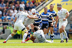 Bath Lock Dave Attwood is tackled by Saracens Lock Alistair Hargreaves (capt) and Flanker Jacques Burger - Photo mandatory by-line: Rogan Thomson/JMP - 07966 386802 - 30/05/2015 - SPORT - RUGBY UNION - London, England - Twickenham Stadium - Bath Rugby v Saracens - 2015 Aviva Premiership Final.