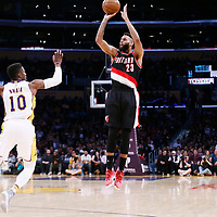 26 March 2016: Portland Trail Blazers guard Allen Crabbe (23) takes a jump shot over Los Angeles Lakers guard David Nwaba (10) during the Portland Trail Blazers 97-81 victory over the Los Angeles Lakers, at the Staples Center, Los Angeles, California, USA.