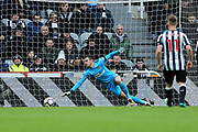 Martin Dubravka (#12) of Newcastle United scrambles across his goal line as he watches the ball drift just wide of the post during the Premier League match between Newcastle United and Huddersfield Town at St. James's Park, Newcastle, England on 31 March 2018. Picture by Craig Doyle.