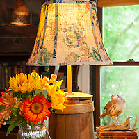 Rustic Cabin: Lamp with firkin base and vase of flowers