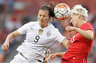 Feb 21, 2016; Houston, TX, USA; USA midfielder Lindsey Horan (9) and Canada midfielder Sophie Schmidt (13)  head the ball in the second half during the 2016 CONCACAF women's Olympic soccer tournament at BBVA Compass Stadium. USA won 2 to 0. Mandatory Credit: Thomas B. Shea-USA TODAY Sports